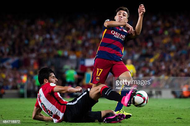 Munir El Haddadi of FC Barcelona and Eneko Boveda of Athletic Club fight for the ball during the Spanish Super Cup second leg match between FC...