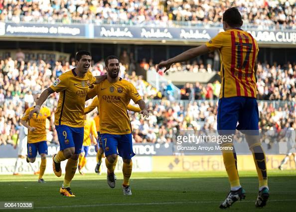 Munir el Haddadi of FC Barcelona celebrates scoring their opening goal with teammates Luis Suarez and Arda Turan during the La Liga match between...