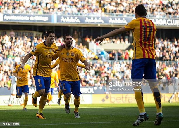 Munir el Haddadi of FC Barcelona celebrates scoring their opening goal with teammates Luis Suarez and Arda Turan during the La Liga match between...
