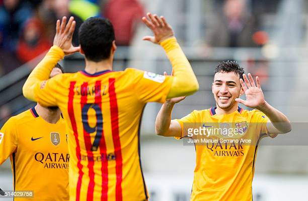 Munir El Haddadi of FC Barcelona celebrates with his teammate Luis Suarez of FC Barcelona after scoring the opening goal during the La Liga match...
