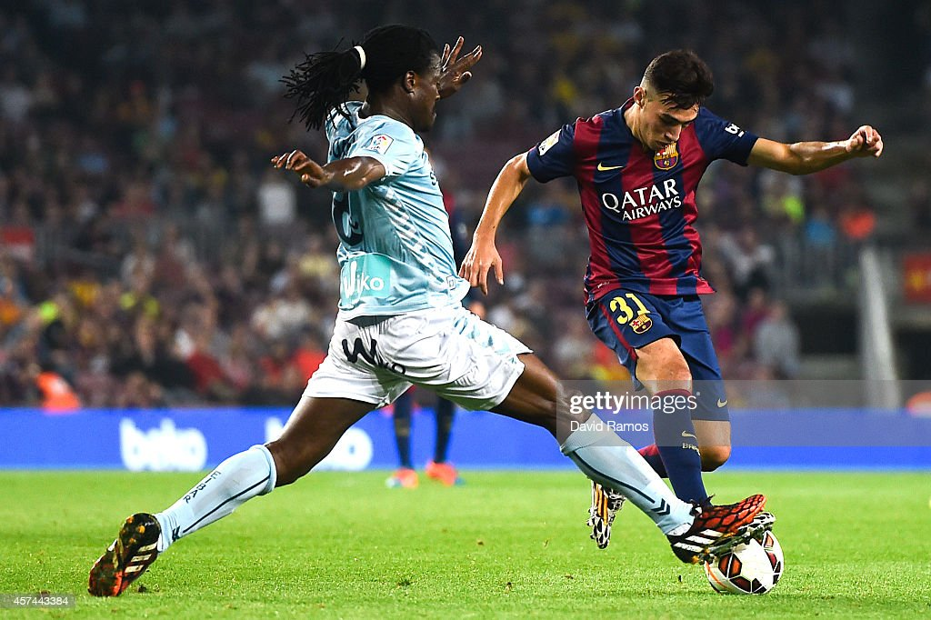 <a gi-track='captionPersonalityLinkClicked' href=/galleries/search?phrase=Munir+El+Haddadi&family=editorial&specificpeople=12554579 ng-click='$event.stopPropagation()'>Munir El Haddadi</a> of FC Barcelona duels for the ball with <a gi-track='captionPersonalityLinkClicked' href=/galleries/search?phrase=Derek+Boateng&family=editorial&specificpeople=535783 ng-click='$event.stopPropagation()'>Derek Boateng</a> of SD Eibar during the La Liga match between FC Barcelona and SD Eibar at Camp Nou on October 18, 2014 in Barcelona, Spain.