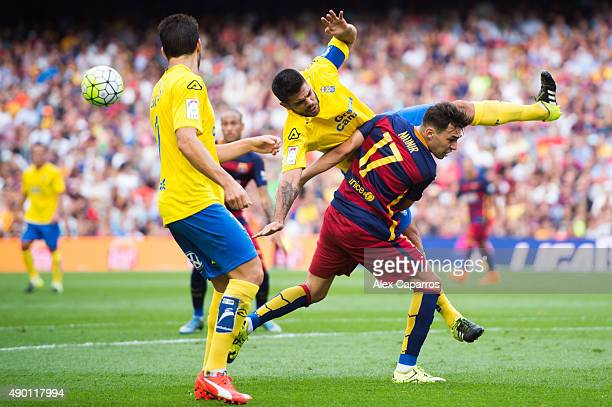 Munir El Haddadi of FC Barcelona fights for the ball with Aythami Artiles of UD Las Palmas during the La Liga match between FC Barcelona and UD Las...