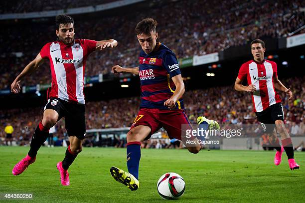 Munir El Haddadi of FC Barcelona kicks the ball next to Eneko Boveda of Athletic Club during the Spanish Super Cup second leg match between FC...