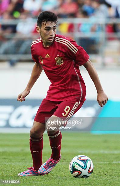 Munir El Haddadi of Spain runs with the ball during the UEFA European Under21 Championship playoff second leg match between Spain and Serbia at the...
