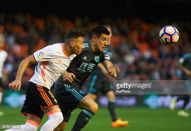 Munir El Haddadi of Valencia CF and Yuri Berchiche of Real Sociedad during their La Liga match between Valencia CF and Real Sociedad at the Mestalla...