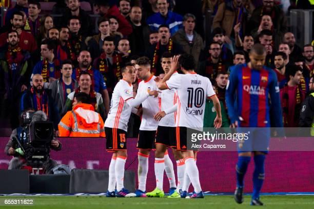 Munir El Haddadi of Valencia CF celebrates with his teammates Fabian Orellana Joao Cancelo and Dani Parejo after scoring his team's second goal...