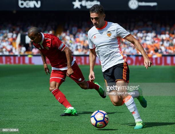 Munir El Haddadi of Valencia competes for the ball with Mariano Ferreira of Sevilla during the La Liga match between Valencia CF and Sevilla FC at...