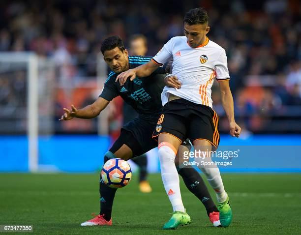 Munir El Haddadi of Valencia competes for the ball with William Jose of Real Sociedad during the La Liga match between Valencia CF and Real Sociedad...