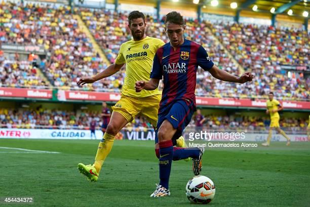 Munir of Barcelona is closed down by Mateo Pablo Musacchio of Villarreal during the La Liga match between Villarreal CF and FC Barcelona at El...