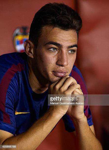 Munir of Barcelona watches from the subsitute bench prior to the La Liga match between Levante UD and FC Barcelona at Ciutat de Valencia on September...