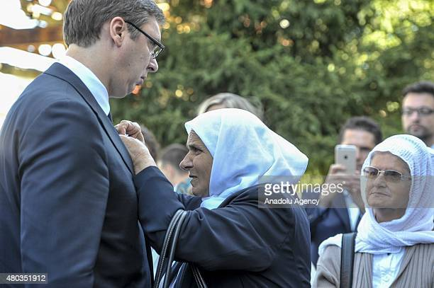 Munira Subasic the president of the Mothers of Srebrenica Association presents Srebrenica flower the symbol of the Srebrenica genocide to Serbian...