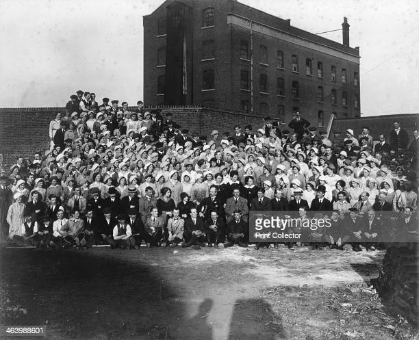 Munitions factory workers London World War I 19141918 Group portrait of workers in a factory producing bombs The photographer's shadow can be seen in...