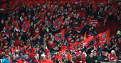 Munster fans celebrate during the European Rugby Champions Cup match between Munster and Saracens at Thomond Park on October 24 2014 in Limerick...