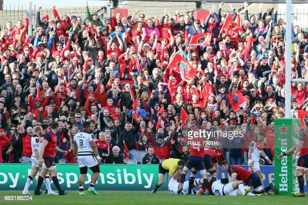 Munster fans celebrate their team's first try during the European Champions Cup quarterfinal rugby union match between Munster and Toulouse at...