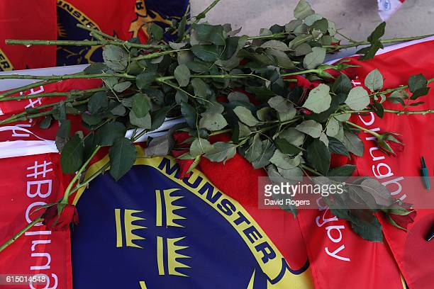 Munster fans place flowers and flags as a mark of respect after hearing of the news of the death of Munster coach Anthony Foley prior to the European...