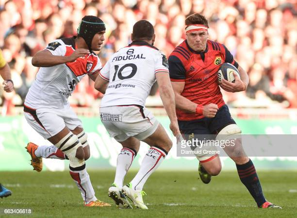 Munster Ireland 1 April 2017 CJ Stander of Munster in action against Thierry Dusautoir left and JeanMarc Doussain of Toulouse during the European...