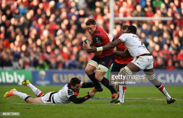 Munster Ireland 1 April 2017 CJ Stander of Munster is tackled by Florian Fritz left and Yacouba Camara of Toulouse during the European Rugby...
