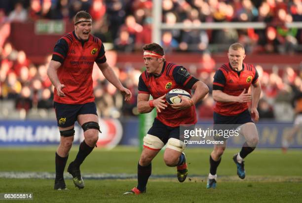 Munster Ireland 1 April 2017 CJ Stander of Munster supported by teammates Donnacha Ryan left and Keith Earls during the European Rugby Champions Cup...