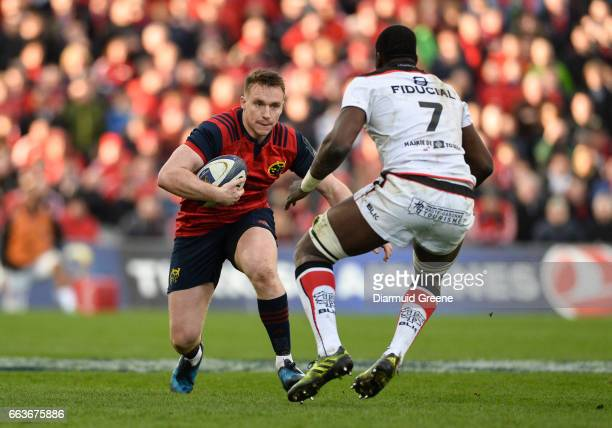 Munster Ireland 1 April 2017 Rory Scannell of Munster in action against Yacouba Camara of Toulouse during the European Rugby Champions Cup...