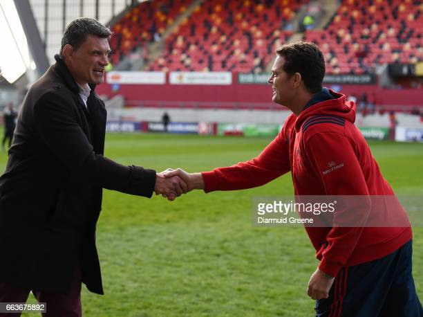 Munster Ireland 1 April 2017 Toulouse sporting director Fabien Pelous left and Munster director of rugby Rassie Erasmus exchange a handshake ahead of...