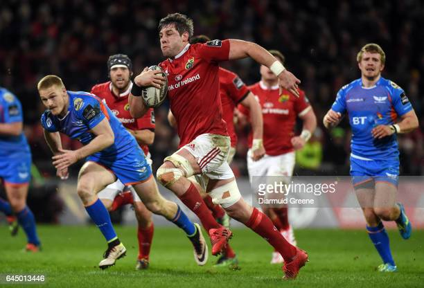 Munster Ireland 24 February 2017 Dave O'Callaghan of Munster gets away from Johnny McNicholl of Scarlets during the Guinness PRO12 Round 16 match...