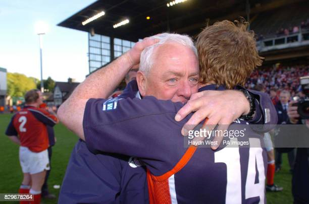 Munster manager Alan Gaffney embraces winger Paul Devlin after his side beat Llanelli Scarlets