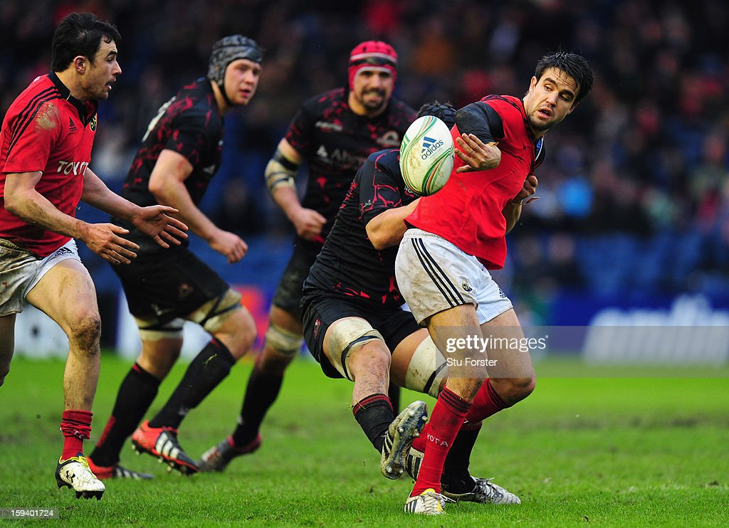 Munster scrum half Conor Murray breaks the tackle of Stuart McInally during the Heineken Cup Round 5 match between Edinburgh and Munster at Murrayfield Stadium on January 13, 2013 in Edinburgh, Scotland.