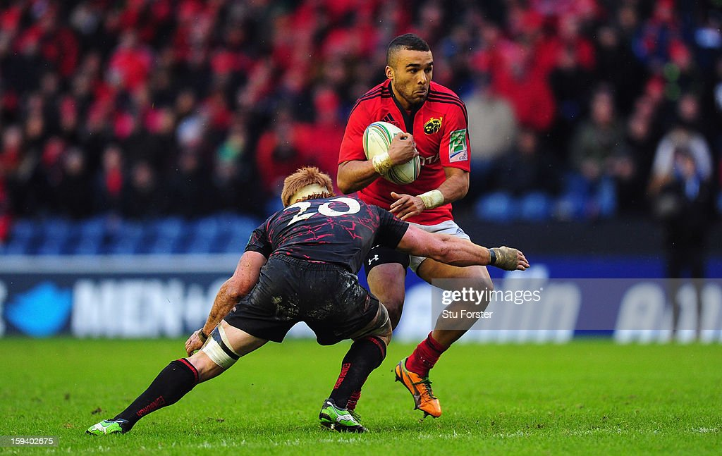 Munster wing Simon Zebo runs into Roddy Grant during the Heineken Cup Round 5 match between Edinburgh and Munster at Murrayfield Stadium on January 13, 2013 in Edinburgh, Scotland.