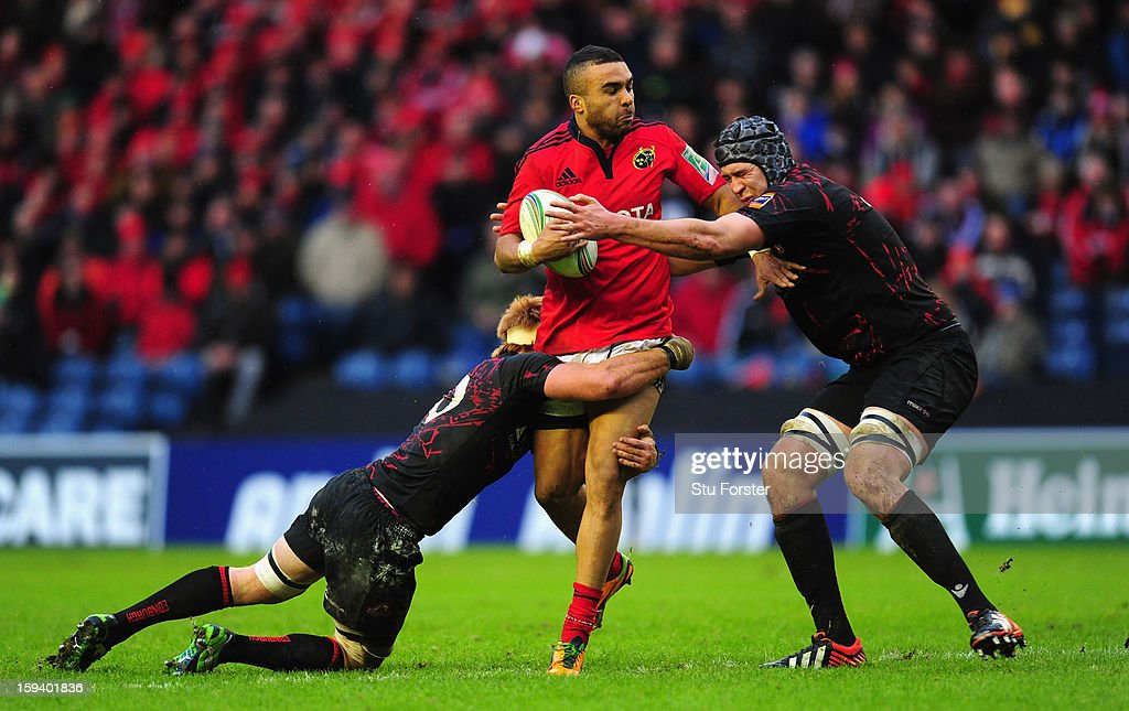 Munster wing Simon Zebo runs into the Edinburgh defence during the Heineken Cup Round 5 match between Edinburgh and Munster at Murrayfield Stadium on January 13, 2013 in Edinburgh, Scotland.