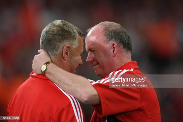 Munster's Coach Declan Kidney hugging Back room staff member David Mahady after the final whistle in the Heineken Cup Final at the Millennium Stadium...