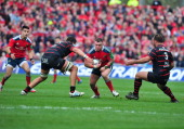 Munster's Dave Kilcoyne atempts to avoid a challenge by Toulouse players Yacouba Camara and Yohan Montes during the rugby union European Cup quarter...