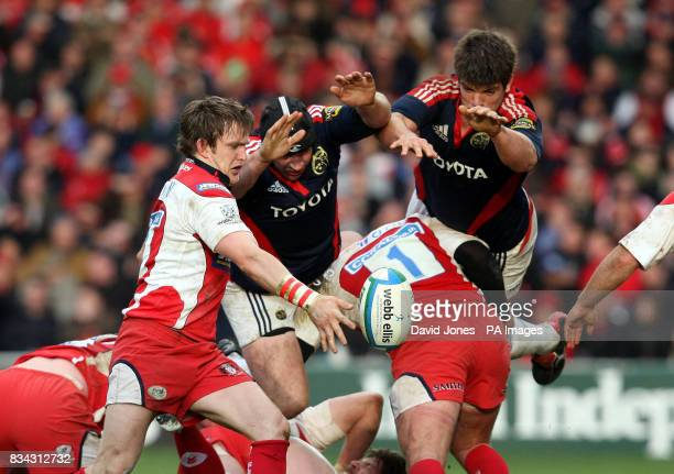 Munster's Denis Leamy and Donncha O'Callaghan try to charge down a clearence kick by Gloucester's Rory Lawson during the Heineken Cup Quarter Final...