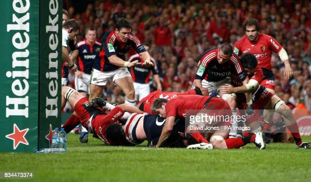 Munster's Denis Leamy crosses for a try against Toulouse during the Heineken Cup Final at the Millennium Stadium Cardiff