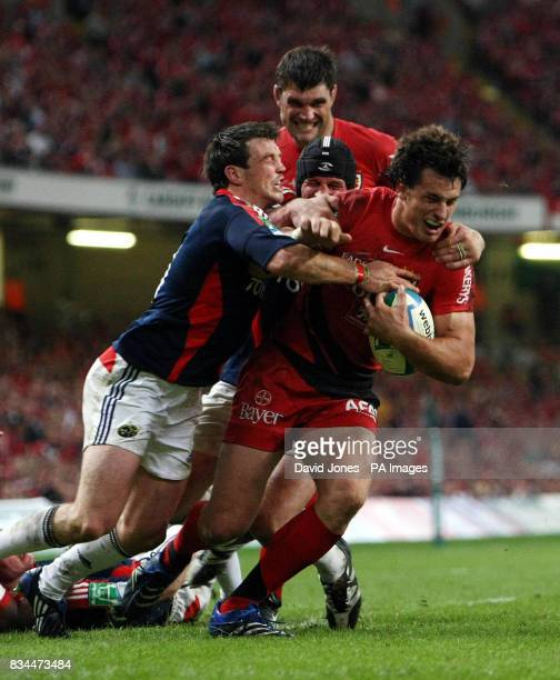 Munster's Ian Dowling tackles Toulouse's Yannick Jauzion during the Heineken Cup Final at the Millennium Stadium Cardiff