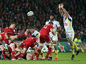 Munster's Irish scrumhalf Conor Murray clears the ball during a European Champions Cup rugby union match between Munster and ASM Clermont Auvergne at...