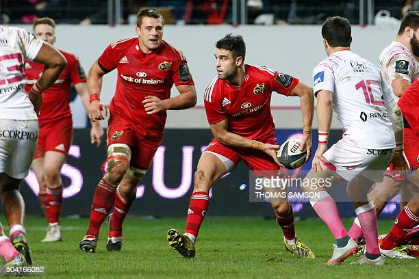 Munster's Irish scrumhalf Conor Murray passes the ball during the European Champions Cup rugby union match between Stade Francais and Munster Rugby...