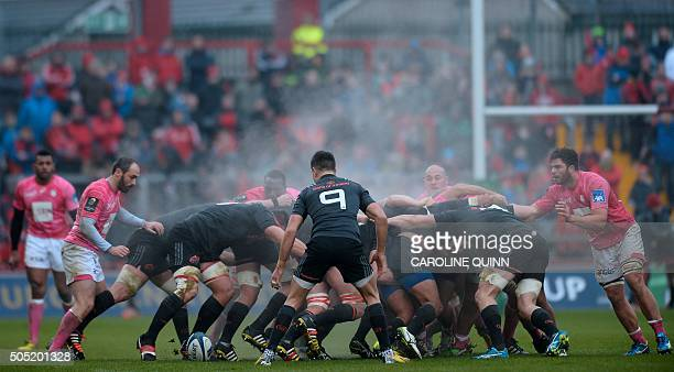 Munster's Irish scrumhalf Conor Murray watches the scrum during the European Rugby Champions Cup rugby union pool match between Munster and Stade...
