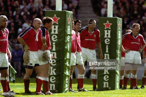 Munster's Keith Wood and Ronan O'Gara watch as another conversion sails over the posts