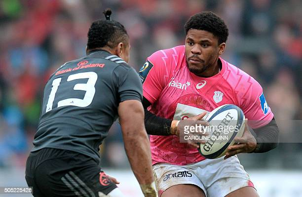 Munster's New Zealand centre Francis Saili vies with Stade Francais Paris's French centre Jonathan Danty during the European Rugby Champions Cup...