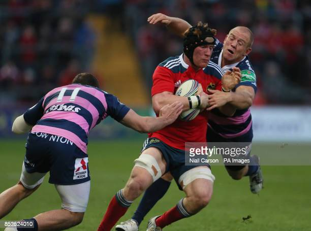 Munster's Niall Ronan and Gloucester's Mike Tindall during the Heineken Cup match at Thomond Park Munster