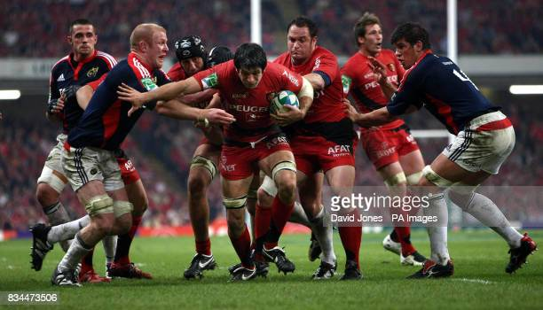 Munster's Paul O'Connel cuts out an attack by Toulouse's Jean Bouilhou during the Heineken Cup Final at the Millennium Stadium Cardiff