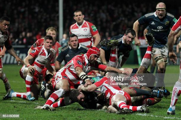 Munster's Peter O'Mahony scores their second try during the Heineken Cup Pool Six match at Kingsholm Stadium Gloucester