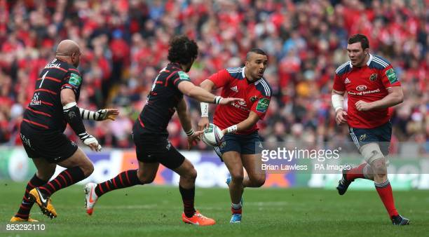 Munster's Simon Zebo and Peter O'Mahony against Toulouse Guthro Steenkamp and Yoann Huget during the Heineken Cup Quarter Final match at Thomond Park...