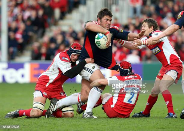 Munster's Tony Buckley is cornered by Gloucester's Andy Hazell Andy Titterell and Rory Lawson during the Heineken Cup Quarter Final match at...