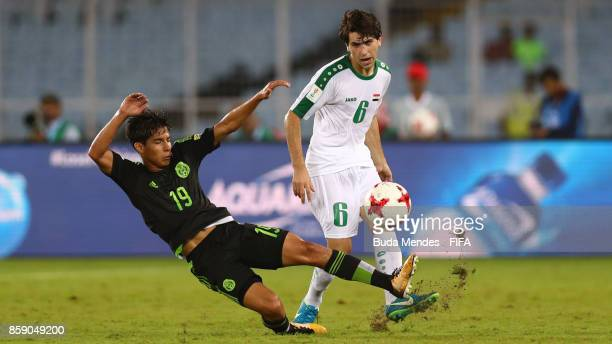 Muntadher Mohammed of Iraq battles for the ball with Diego Lainez of Mexico during the FIFA U17 World Cup India 2017 group F match between Iraq and...