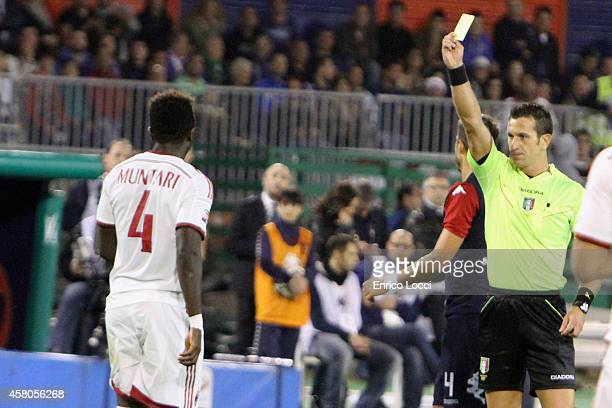 Muntari of Milan receives the yellow card during the Serie A match between Cagliari Calcio and AC Milan at Stadio Sant'Elia on October 29 2014 in...