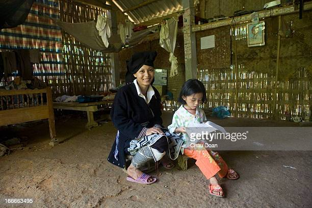 Muong ethnic minority woman Ly Thi Trung with her daughter Dang Thi Trang at their house in Tra Ang hamlet Vay Nua commune Da Bac district Hoa Binh...