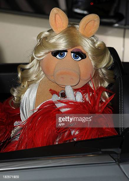 Muppet Miss Peggy arrives for the premiere of Walt Disney Pictures' 'The Muppets' at the El Capitan Theatre in Hollywood on November 12 2011 AFP...