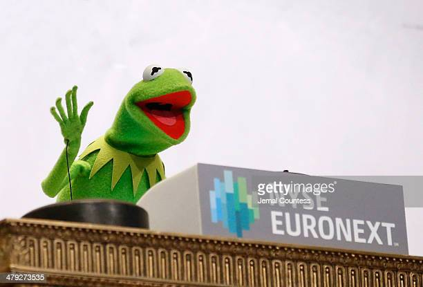 Muppets character Kermit the Frog waves after ringing the opening bell at the New York Stock Exchange on March 17 2014 in New York City