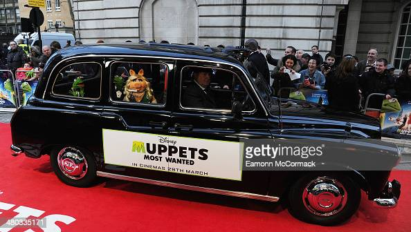 Muppets characters Miss Piggy Kermit and Costantine arrive by London Taxi to the VIP screening of 'The Muppets Most Wanted' at The Curzon Mayfair on...